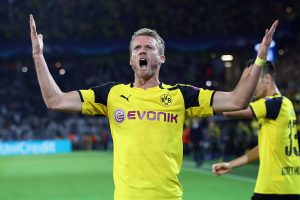 DORTMUND, GERMANY - SEPTEMBER 27:  Andre Schuerrle of Dortmund celebrates his team's second goal during the UEFA Champions League Group F match between Borussia Dortmund and Real Madrid CF at Signal Iduna Park on September 27, 2016 in Dortmund, North Rhine-Westphalia.  (Photo by Alex Grimm/Bongarts/Getty Images)
