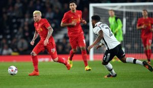 Liverpool's Spanish defender Alberto Moreno (L) runs after the ball in front of Derby's English-born Irish defender Cyrus Christie (R) during the English League Cup third-round football match between Derby County and Liverpool at iPro Stadium in Derby, central England on September 20, 2016. / AFP / PAUL ELLIS / RESTRICTED TO EDITORIAL USE. No use with unauthorized audio, video, data, fixture lists, club/league logos or 'live' services. Online in-match use limited to 75 images, no video emulation. No use in betting, games or single club/league/player publications.  /         (Photo credit should read PAUL ELLIS/AFP/Getty Images)