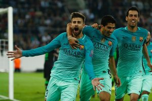Barcelona's defender Gerard Pique (L) celebrates scoring the 1-2 goal with his teammates Uruguayan forward Luis Suarez and midfielder Sergio Busquets during the UEFA Champions League first-leg group C football match between Borussia Moenchengladbach and FC Barcelona at the Borussia Park in Moenchengladbach, western Germany on September 28, 2016. / AFP / Odd ANDERSEN        (Photo credit should read ODD ANDERSEN/AFP/Getty Images)