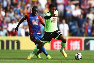 LONDON, ENGLAND - AUGUST 27:  Lewis Grabban of AFC Bournemouth takes the ball away from Christian Benteke of Crystal Palace during the Premier League match between Crystal Palace and AFC Bournemouth at Selhurst Park on August 27, 2016 in London, England.  (Photo by Bryn Lennon/Getty Images)