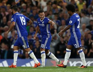 Chelsea's Belgian midfielder Eden Hazard (C) celebrates with Chelsea's Brazilian midfielder Willian (R) after scoring the opening goal from the penalty spot during the English Premier League football match between Chelsea and West Ham United at Stamford Bridge in London on August 15, 2016. / AFP / Justin TALLIS / RESTRICTED TO EDITORIAL USE. No use with unauthorized audio, video, data, fixture lists, club/league logos or 'live' services. Online in-match use limited to 75 images, no video emulation. No use in betting, games or single club/league/player publications.  /         (Photo credit should read JUSTIN TALLIS/AFP/Getty Images)