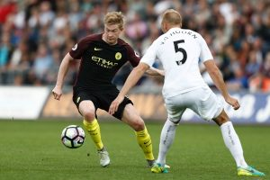 Manchester City's Belgian midfielder Kevin De Bruyne (L) takes on Swansea City's Dutch defender Mike van der Hoorn (R) during the English Premier League football match between Swansea City and Manchester City at The Liberty Stadium in Swansea, south Wales on September 24, 2016. / AFP / Adrian DENNIS / RESTRICTED TO EDITORIAL USE. No use with unauthorized audio, video, data, fixture lists, club/league logos or 'live' services. Online in-match use limited to 75 images, no video emulation. No use in betting, games or single club/league/player publications.  /         (Photo credit should read ADRIAN DENNIS/AFP/Getty Images)