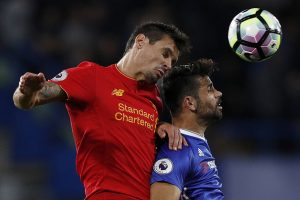 Liverpool's Croatian defender Dejan Lovren (L) and Chelsea's Brazilian-born Spanish striker Diego Costa vie for the ball during the English Premier League football match between Chelsea and Liverpool at Stamford Bridge in London on September 16, 2016. / AFP / Adrian DENNIS / RESTRICTED TO EDITORIAL USE. No use with unauthorized audio, video, data, fixture lists, club/league logos or 'live' services. Online in-match use limited to 75 images, no video emulation. No use in betting, games or single club/league/player publications.  /         (Photo credit should read ADRIAN DENNIS/AFP/Getty Images)