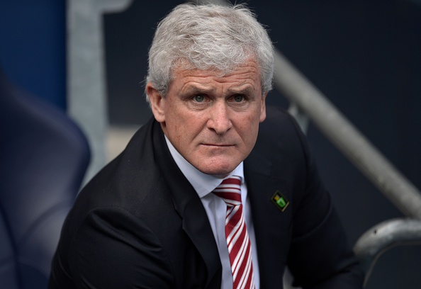 Stoke City's Welsh manager Mark Hughes arrives for the English Premier League football match between Manchester City and Stoke City at the Etihad Stadium in Manchester, north west England, on April 23, 2016. / AFP / OLI SCARFF / RESTRICTED TO EDITORIAL USE. No use with unauthorized audio, video, data, fixture lists, club/league logos or 'live' services. Online in-match use limited to 75 images, no video emulation. No use in betting, games or single club/league/player publications.  /         (Photo credit should read OLI SCARFF/AFP/Getty Images)