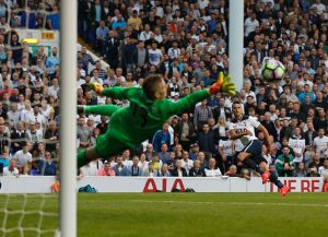 Tottenham Hotspur's Argentinian midfielder Erik Lamela (R) sees his shot saved by Sunderland's English goalkeeper Jordan Pickford during the English Premier League football match between Tottenham Hotspur and Sunderland at White Hart Lane in London, on September 18, 2016. / AFP / Ian KINGTON / RESTRICTED TO EDITORIAL USE. No use with unauthorized audio, video, data, fixture lists, club/league logos or 'live' services. Online in-match use limited to 75 images, no video emulation. No use in betting, games or single club/league/player publications.  /         (Photo credit should read IAN KINGTON/AFP/Getty Images)