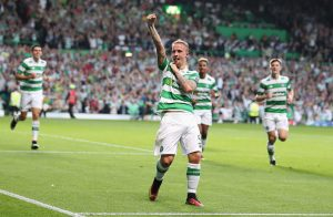 GLASGOW, SCOTLAND - AUGUST 17:  Leigh Griffiths of Celtic celebrates scoring his team's third goal during the UEFA Champions League Play-off First leg match between Celtic and Hapoel Beer-Sheva at Celtic Park on August 17, 2016 in Glasgow, Scotland.  (Photo by Steve Welsh/Getty Images)