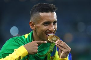 RIO DE JANEIRO, BRAZIL - AUGUST 20:  Marquinhos of Brazil celebrates with his gold medal following the Men's Football Final between Brazil and Germany at the Maracana Stadium on Day 15 of the Rio 2016 Olympic Games on August 20, 2016 in Rio de Janeiro, Brazil.  (Photo by Clive Mason/Getty Images)