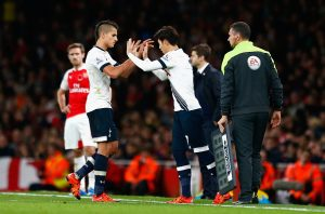 LONDON, ENGLAND - NOVEMBER 08:  Erik Lamela of Spurs (L) is substituted for Son Heung-Min of Spurs during the Barclays Premier League match between Arsenal and Tottenham Hotspur at the Emirates Stadium on November 8, 2015 in London, England.  (Photo by Julian Finney/Getty Images)