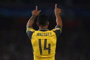 LONDON, ENGLAND - SEPTEMBER 28:  Theo Walcott of Arsenal celebrates his second goal during the UEFA Champions League Group A match between Arsenal FC and FC Basel 1893 at Emirates Stadium on September 28, 2016 in London, England.  (Photo by Mike Hewitt/Getty Images)
