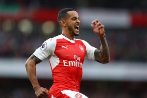 LONDON, ENGLAND - SEPTEMBER 24:  Theo Walcott of Arsenal celebrates scoring his sides second goal during the Premier League match between Arsenal and Chelsea at the Emirates Stadium on September 24, 2016 in London, England.  (Photo by Paul Gilham/Getty Images)