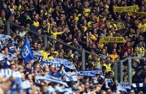 GELSENKIRCHEN, GERMANY - SEPTEMBER 27:  Fans of Schalke and Dortmund are seen during the Bundesliga match between FC Schalke 04 and Borussia Dortmund at Veltins Arena on September 27, 2014 in Gelsenkirchen, Germany.  (Photo by Lars Baron/Bongarts/Getty Images)