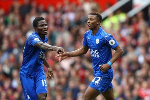 MANCHESTER, ENGLAND - SEPTEMBER 24:  Demarai Gray of Leicester City (R) celebrates scoring his sides first goal with Daniel Amartey of Leicester City (L)during the Premier League match between Manchester United and Leicester City at Old Trafford on September 24, 2016 in Manchester, England.  (Photo by Clive Brunskill/Getty Images)