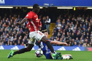 Manchester United's Ivorian defender Eric Bailly vies with Chelsea's English defender Gary Cahill (R) during the English Premier League football match between Chelsea and Manchester United at Stamford Bridge in London on October 23, 2016. / AFP / GLYN KIRK / RESTRICTED TO EDITORIAL USE. No use with unauthorized audio, video, data, fixture lists, club/league logos or 'live' services. Online in-match use limited to 75 images, no video emulation. No use in betting, games or single club/league/player publications.  /         (Photo credit should read GLYN KIRK/AFP/Getty Images)