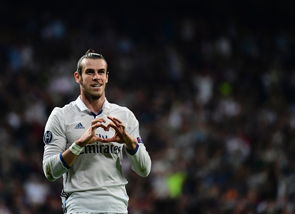 Real Madrid's Welsh forward Gareth Bale celebrates after scoring during the UEFA Champions League football match Real Madrid CF vs Legia  Legia Warszawa at the Santiago Bernabeu stadium in Madrid on October 18, 2016. / AFP / PIERRE-PHILIPPE MARCOU        (Photo credit should read PIERRE-PHILIPPE MARCOU/AFP/Getty Images)