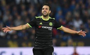 Chelsea's Spanish midfielder Cesc Fabregas celebrates scoring their fourth goal during extra-time in the English League Cup third round football match between Leicester City and Chelsea at King Power Stadium in Leicester, central England on September 20, 2016. / AFP / Anthony DEVLIN / RESTRICTED TO EDITORIAL USE. No use with unauthorized audio, video, data, fixture lists, club/league logos or 'live' services. Online in-match use limited to 75 images, no video emulation. No use in betting, games or single club/league/player publications.  /         (Photo credit should read ANTHONY DEVLIN/AFP/Getty Images)