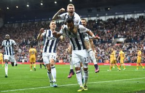 WEST BROMWICH, ENGLAND - OCTOBER 15: James McClean of West Bromwich Albion (C) jumps on Nacer Chadli of West Bromwich Albion (C) as he celebrates scoring his sides first goal  during the Premier League match between West Bromwich Albion and Tottenham Hotspur at The Hawthorns on October 15, 2016 in West Bromwich, England.  (Photo by Michael Regan/Getty Images)