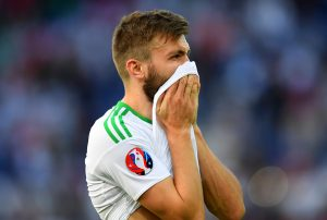 PARIS, FRANCE - JUNE 25:  Stuart Dallas of Northern Ireland shows his dejection after his team's 0-1 defeat in the UEFA EURO 2016 round of 16 match between Wales and Northern Ireland at Parc des Princes on June 25, 2016 in Paris, France.  (Photo by Matthias Hangst/Getty Images)