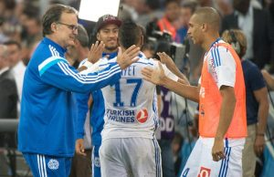 Marseille's Argentine head coach Marcelo Bielsa (L) celebrates with Marseille's Brazilian defender Doria at the end of the French L1 football match between Marseille and Saint-Etienne at the Velodrome stadium in Marseille, southern France, on September 28, 2014. AFP PHOTO / BERTRAND LANGLOIS        (Photo credit should read BERTRAND LANGLOIS/AFP/Getty Images)