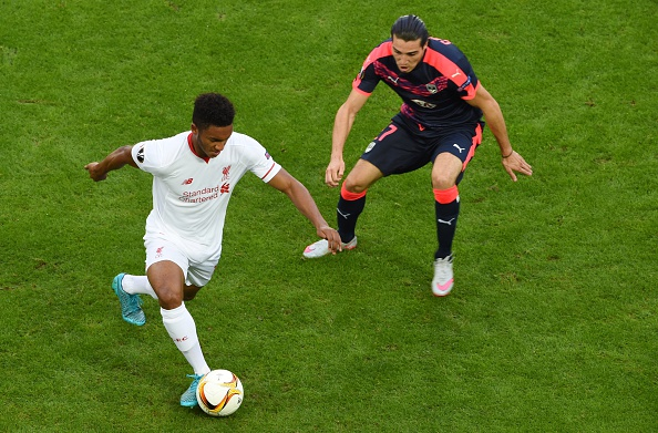 Liverpool's English defender Joe Gomez (L) vies with Bordeaux's forward Enzo Crivelli (R) during the group B, UEFA Europa League football match between Bordeaux vs Liverpool on September 17, 2015 at the Matmut Atlantique Stadium in Bordeaux.  AFP PHOTO / MEHDI FEDOUACH        (Photo credit should read MEHDI FEDOUACH/AFP/Getty Images)