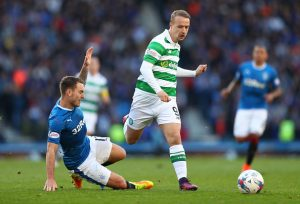 GLASGOW, SCOTLAND - OCTOBER 23:  Leigh Griffiths of Celtic rides a tackle from Rob Kiernan of Rangers during the Betfred Cup Semi Final match between Rangers and Celtic at Hampden Park on October 23, 2016 in Glasgow, Scotland.  (Photo by Michael Steele/Getty Images)