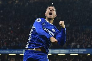Chelsea's Belgian midfielder Eden Hazard celebrates after scoring their third goal during the English Premier League football match between Chelsea and Manchester United at Stamford Bridge in London on October 23, 2016. / AFP / Glyn KIRK / RESTRICTED TO EDITORIAL USE. No use with unauthorized audio, video, data, fixture lists, club/league logos or 'live' services. Online in-match use limited to 75 images, no video emulation. No use in betting, games or single club/league/player publications.  /         (Photo credit should read GLYN KIRK/AFP/Getty Images)