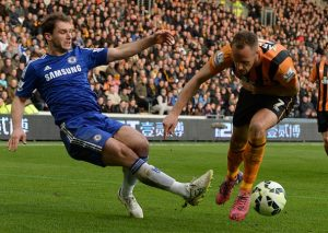 """Hull City's Irish midfielder David Meyler (R) vies with Chelsea's Serbian defender Branislav Ivanovic during the English Premier League football match between Hull City and Chelsea at the KC Stadium in Kingston upon Hull, north east England on March 22, 2015.  AFP PHOTO / NIGEL RODDIS  RESTRICTED TO EDITORIAL USE. No use with unauthorized audio, video, data, fixture lists, club/league logos or """"live"""" services. Online in-match use limited to 45 images, no video emulation. No use in betting, games or single club/league/player publications.        (Photo credit should read NIGEL RODDIS/AFP/Getty Images)"""