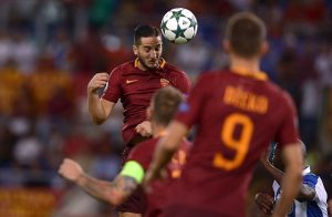 Roma's Greek defender Kostas Manolas (L) heads the ball during the UEFA Champions League second leg play off football match between AS Roma and FC Porto on August 23, 2016 the Olympic Stadium in Rome. / AFP / FILIPPO MONTEFORTE        (Photo credit should read FILIPPO MONTEFORTE/AFP/Getty Images)