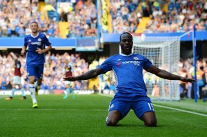 Chelsea's Nigerian midfielder Victor Moses celebrates after scoring during the English Premier League football match between Chelsea and Burnley at Stamford Bridge in London on August 27, 2016. / AFP / GLYN KIRK / RESTRICTED TO EDITORIAL USE. No use with unauthorized audio, video, data, fixture lists, club/league logos or 'live' services. Online in-match use limited to 75 images, no video emulation. No use in betting, games or single club/league/player publications.  /         (Photo credit should read GLYN KIRK/AFP/Getty Images)