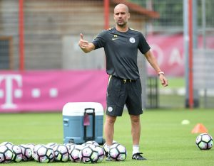 Manchester's new Spanish headcoach Pep Guardiola attends a training session of Manchester City at the training ground of the German first division football team FC Bayern Munich in Munich, southern Germany, on July 21, 2016.  / AFP / CHRISTOF STACHE        (Photo credit should read CHRISTOF STACHE/AFP/Getty Images)
