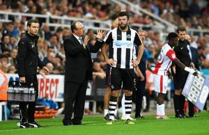 NEWCASTLE UPON TYNE, ENGLAND - AUGUST 23:  Rafael Benitez, Manager of Newcastle United speaks to Grant Hanley of Newcastle United during the EFL Cup second round match between Newcastle United and Cheltenham Town at St. James' Park on August 23, 2016 in Newcastle upon Tyne, England.  (Photo by Stu Forster/Getty Images)