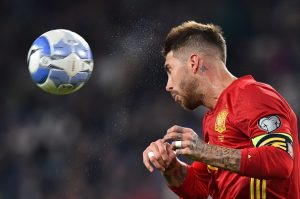 Spain's defender Sergio Ramos heads off the ball during the WC 2018 football qualification match between Italy and Spain on October 6, 2016 at the Juventus stadium in Turin / AFP / GIUSEPPE CACACE        (Photo credit should read GIUSEPPE CACACE/AFP/Getty Images)