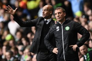 Manchester City's Spanish manager Pep Guardiola (L) and Celtic's Northern Irish manager Brendan Rodgers react as they watch the touchline during the UEFA Champions League Group C football match between Celtic and Manchester City at Celtic Park stadium in Glasgow, Scotland on September 28, 2016. / AFP / OLI SCARFF        (Photo credit should read OLI SCARFF/AFP/Getty Images)
