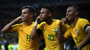 Brazil's Neymar (C) celebrates with teammates Philippe Coutinho (L) and Gabriel Jesus after scoring against Argentina during their 2018 FIFA World Cup qualifier football match in Belo Horizonte, Brazil, on November 10, 2016. / AFP / VANDERLEI ALMEIDA        (Photo credit should read VANDERLEI ALMEIDA/AFP/Getty Images)