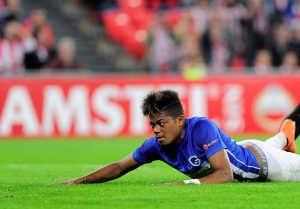 Genk's Jamaican midfielder Leon Bailey lies on the pitch just after scoring during the Europa League Group F football match Athletic Club de Bilbao vs KRC Genk at the San Mames stadium in Bilbao on November 3, 2016. / AFP / ANDER GILLENEA        (Photo credit should read ANDER GILLENEA/AFP/Getty Images)