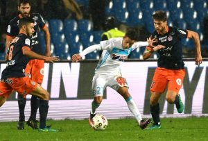 Olympique de Marseille's French midfielder Maxime Lopez (C) vies with Montpellier's French midfielder Paul Lasne (R) and Montpellier's French midfielder Morgan Sanson (L) during the French L1 football match between Montpellier and Marseille at the La Mosson Stadium in Montpellier, southern France, on November 4, 2016. / AFP / PASCAL GUYOT        (Photo credit should read PASCAL GUYOT/AFP/Getty Images)