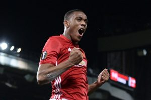 Manchester United's French striker Anthony Martial celebrates scoring their second goal from the penalty spot during the UEFA Europa League group A football match between Manchester United and Fenerbahce at Old Trafford in Manchester, north west England, on October 20, 2016. / AFP / OLI SCARFF        (Photo credit should read OLI SCARFF/AFP/Getty Images)