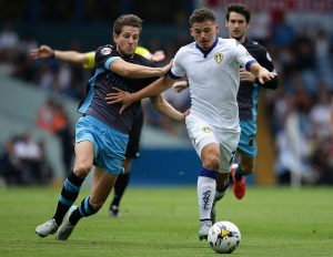 LEEDS, ENGLAND - AUGUST 22:  Kalvin Phillips of Leeds United FC olds off Sam Hutchinson of Sheffield Wednesday FC  during the Sky Bet Championship match between Leeds United and Sheffield Wednesday at Elland Road on August 22, 2015 in Leeds, England.  (Photo by Daniel Smith/Getty Images)