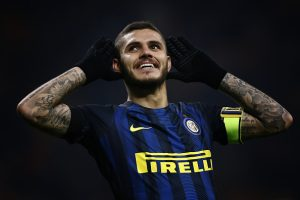 Inter Milan's forward Mauro Emanuel Icardi from Argentina celebrates after scoring during the Italian Serie A football match Inter Milan Vs Crotone on November 6, 2016 at the 'San Siro Stadium' in Milan.  / AFP / MARCO BERTORELLO        (Photo credit should read MARCO BERTORELLO/AFP/Getty Images)