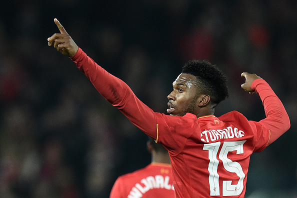 Liverpool's English striker Daniel Sturridge celebrates after scoring their second goal during the EFL (English Football League) Cup fourth round match between Liverpool and Tottenham Hotspur at Anfield in Liverpool north west England on October 25, 2016. / AFP / Oli SCARFF / RESTRICTED TO EDITORIAL USE. No use with unauthorized audio, video, data, fixture lists, club/league logos or 'live' services. Online in-match use limited to 75 images, no video emulation. No use in betting, games or single club/league/player publications.  /         (Photo credit should read OLI SCARFF/AFP/Getty Images)