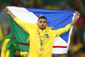 RIO DE JANEIRO, BRAZIL - AUGUST 20:  Thiago Maia of Brazil celebrates after the Men's Football Final between Brazil and Germany at the Maracana Stadium on Day 15 of the Rio 2016 Olympic Games on August 20, 2016 in Rio de Janeiro, Brazil.  (Photo by Clive Mason/Getty Images)