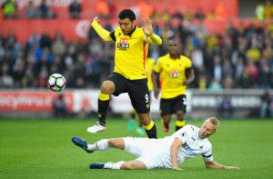 SWANSEA, WALES - OCTOBER 22: Troy Deeney of Watford is tackled by Mike van der Hoorn of Swansea City during the Premier League match between Swansea City and Watford at the Liberty Stadium on October 22, 2016 in Swansea, Wales.  (Photo by Stu Forster/Getty Images)
