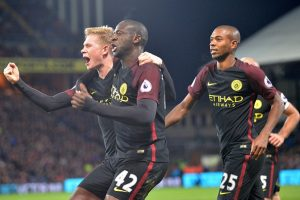 Manchester City's Ivorian midfielder Yaya Toure (C) celebrates with Manchester City's Belgian midfielder Kevin De Bruyne (L) and Manchester City's Brazilian midfielder Fernandinho (R) after scoring their second goal during the English Premier League football match between Crystal Palace and Manchester City at Selhurst Park in south London on November 19, 2016. Manchester City won the game 2-1. / AFP / OLLY GREENWOOD / RESTRICTED TO EDITORIAL USE. No use with unauthorized audio, video, data, fixture lists, club/league logos or 'live' services. Online in-match use limited to 75 images, no video emulation. No use in betting, games or single club/league/player publications.  /         (Photo credit should read OLLY GREENWOOD/AFP/Getty Images)