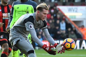 Liverpool's German goalkeeper Loris Karius gathers the ball during the English Premier League football match between Bournemouth and Liverpool at the Vitality Stadium in Bournemouth, southern England on December 4, 2016. Bournemouth won the game 4-3. / AFP / Glyn KIRK / RESTRICTED TO EDITORIAL USE. No use with unauthorized audio, video, data, fixture lists, club/league logos or 'live' services. Online in-match use limited to 75 images, no video emulation. No use in betting, games or single club/league/player publications.  /         (Photo credit should read GLYN KIRK/AFP/Getty Images)