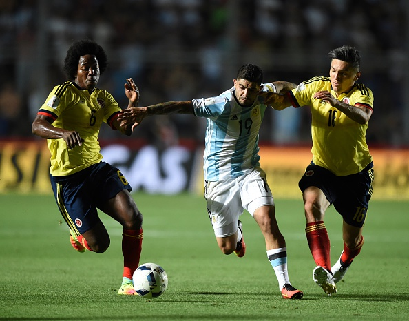 Argentina's Ever Banega (C) is marked by Colombia's Carlos Sanchez (L) and Daniel Torres during their 2018 FIFA World Cup qualifier football match in San Juan, Argentina, on November 15, 2016. / AFP / EITAN ABRAMOVICH        (Photo credit should read EITAN ABRAMOVICH/AFP/Getty Images)