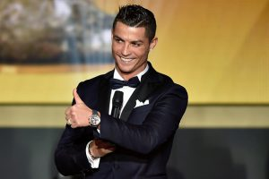 Real Madrid and Portugal's forward Cristiano Ronaldo gestures on stage during the 2015 FIFA Ballon d'Or award ceremony at the Kongresshaus in Zurich on January 11, 2016. AFP PHOTO / FABRICE COFFRINI / AFP / FABRICE COFFRINI        (Photo credit should read FABRICE COFFRINI/AFP/Getty Images)