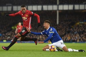 Manchester United's French striker Anthony Martial (L) vies with Everton's English defender Mason Holgate during the English Premier League football match between Everton and Manchester United at Goodison Park in Liverpool, north west England on December 4, 2016. The game ended 1-1. / AFP / Paul ELLIS / RESTRICTED TO EDITORIAL USE. No use with unauthorized audio, video, data, fixture lists, club/league logos or 'live' services. Online in-match use limited to 75 images, no video emulation. No use in betting, games or single club/league/player publications.  /         (Photo credit should read PAUL ELLIS/AFP/Getty Images)