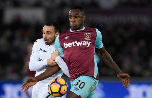 SWANSEA, WALES - DECEMBER 26:  Leon Britton of Swansea City (l) challenges Michail Antonio of West Ham United during the Premier League match between Swansea City and West Ham United at Liberty Stadium on December 26, 2016 in Swansea, Wales.  (Photo by Stu Forster/Getty Images)