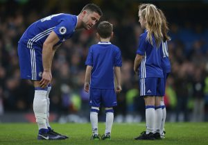 LONDON, ENGLAND - DECEMBER 31: Gary Cahill of Chelsea talks to the match day mascots during the Premier League match between Chelsea and Stoke City at Stamford Bridge on December 31, 2016 in London, England. (Photo by Steve Bardens/Getty Images)