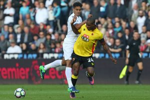 Watford's Nigerian striker Odion Ighalo (R) vies with Swansea City's English defender Kyle Naughton during the English Premier League football match between Swansea City and Watford at The Liberty Stadium in Swansea, south Wales on October 22, 2016. / AFP / Geoff CADDICK / RESTRICTED TO EDITORIAL USE. No use with unauthorized audio, video, data, fixture lists, club/league logos or 'live' services. Online in-match use limited to 75 images, no video emulation. No use in betting, games or single club/league/player publications.  /         (Photo credit should read GEOFF CADDICK/AFP/Getty Images)