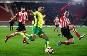 SOUTHAMPTON, ENGLAND - JANUARY 18:  Josh Murphy of Norwich City is challenged by Maya Yoshida of Southampton during The Emirates FA Cup Third Round Replay match between Southampton and Norwich City at St Mary's Stadium on January 18, 2017 in Southampton, England.  (Photo by Julian Finney/Getty Images)